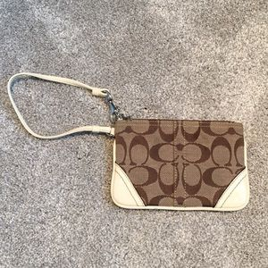 Coach wristlet. White and brown.